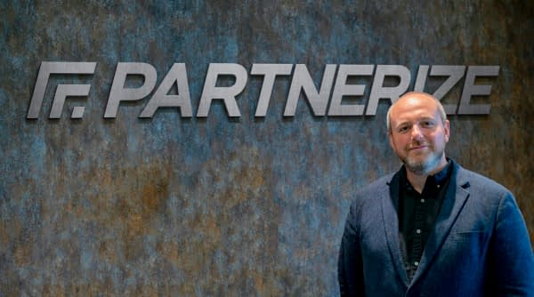 Partnerize Logo and CEO Malcolm Cowley